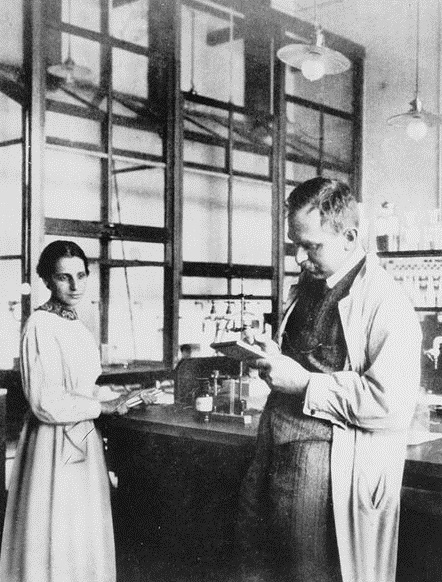 Lise Meitner and Otto Hahn in a laboratory circa 1913