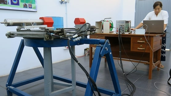researcher prepares equipment to be used in non destructive testing
