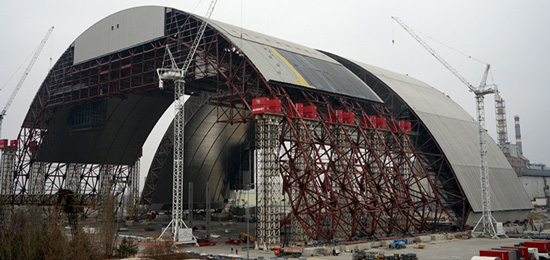 Chernobyl New Safe Confinement under construction and before being moved into place